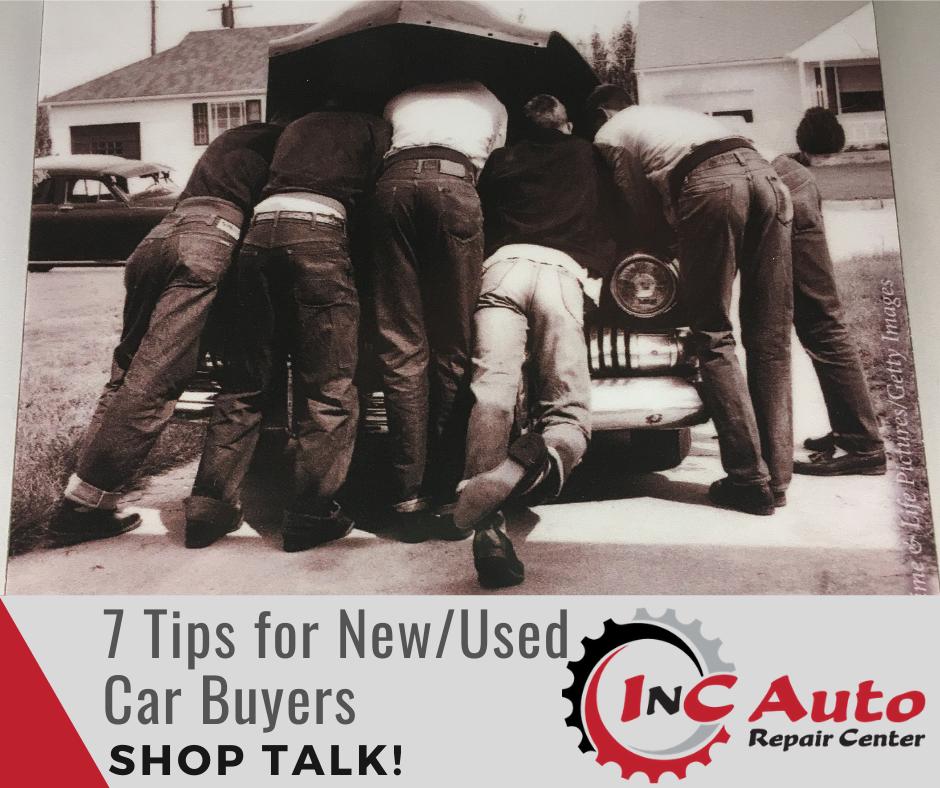 1950's Vintage image of 5 men huddled around an open car engine